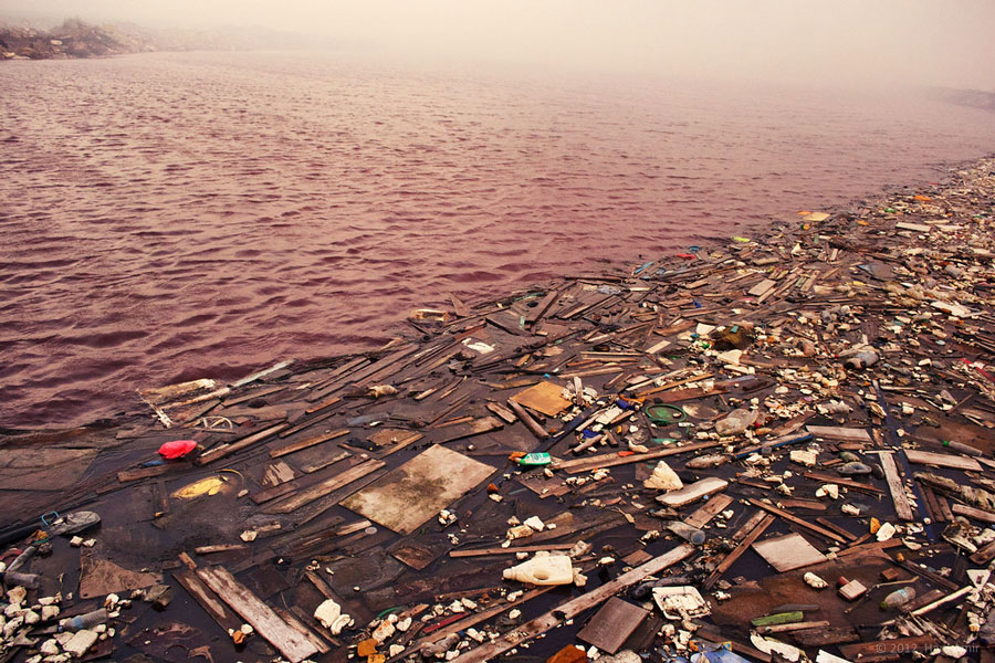 photo of trash on an ocean shore showing importance of earth day